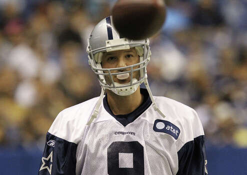 Quarterback Tony Romo blows a bubble with his gum during warmups at the afternoon session of the Dallas Cowboys training camp at the Alamodome on Thursday, July 28, 2011. Photo: Kin Man Hui, San Antonio Express-News / SAN ANTONIO EXPRESS-NEWS