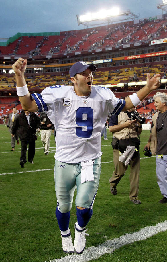 Dallas Cowboys quarterback Tony Romo celebrates as he leaves the field after winning an NFL football game in overtime against the Washington Redskins in Landover, Md., on Sunday, Nov. 20, 2011. The Cowboys won 27-24. Photo: Evan Vucci, Associated Press / AP