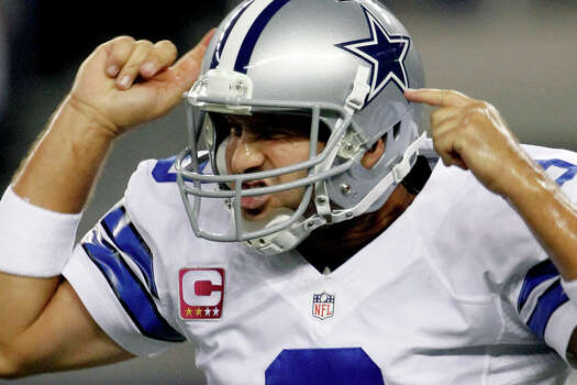 Dallas Cowboys quarterback Tony Romo (9) celebrates his touchdown pass to wide receiver Miles Austin during the first half of an NFL football game against the Chicago Bears, Monday, Oct. 1, 2012, in Arlington. Photo: Tony Gutierrez, Associated Press / AP