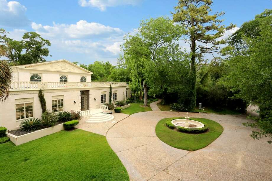 This four-acre estate has plenty to offer potential owners. The home features four bedrooms and more than 7,500 square feet, including a second home in the rear of the property. Photo: HAR.com
