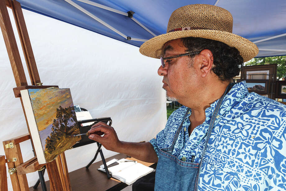 Local artist Pauly Tamez works on a scenic oil painting during  Best of BoerneFest 2013 at Main Plaza in Boerne on Saturday, May 18, 2013.  Photo by Marvin Pfeiffer / Prime Time Newspapers Photo: MARVIN PFEIFFER, Marvin Pfeiffer / Prime Time New / Prime Time Newspapers 2013