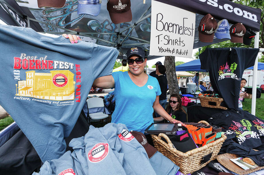 Lorraine Daniel with CH Graphics sells Boerne-related merchandise, including BoerneFest 2013 t-shirts designed by her company during the second annual Best of BoerneFest at Main Plaza in Boerne on Saturday, May 18, 2013.  Photo by Marvin Pfeiffer / Prime Time Newspapers Photo: MARVIN PFEIFFER, Marvin Pfeiffer / Prime Time New / Prime Time Newspapers 2013