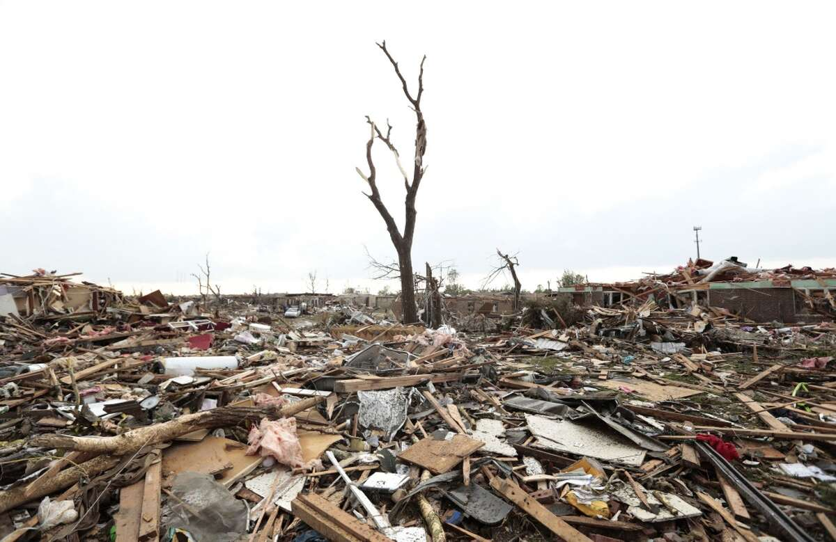 MOORE, OK - MAY 20: Massive piles of debris cover the ground after a powerful tornado ripped through the area on May 20, 2013 in Moore, Oklahoma. The tornado, reported to be at least EF4 strength and two miles wide, touched down in the Oklahoma City area on Monday killing at least 51 people. (Photo by Brett Deering/Getty Images)