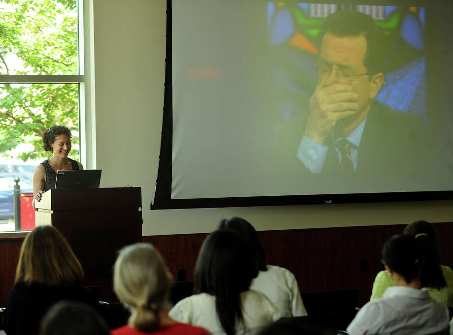 Emily Bazelon, author of bullying book Sticks and Stones, shows her television interview with talk show host Stephen Colbert during a talk at Fairfield University in Fairfield, Conn. on Tuesday, May 21, 2013. Bazelon, who on the show told Colbert that he could be considered a bully, joked that she now has the distinction of being the guest who made Colbert cry. Photo: Brian A. Pounds / Connecticut Post