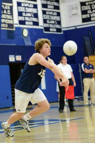 Staples High School's Jonathan Denowitz returns a serve in the CIAC Boys Volleyball Class L quarterfinal game vs Southington High School held at Staples High School, Friday June 1st, 2012. Photo: Mark Conrad / Connecticut Post Freelance