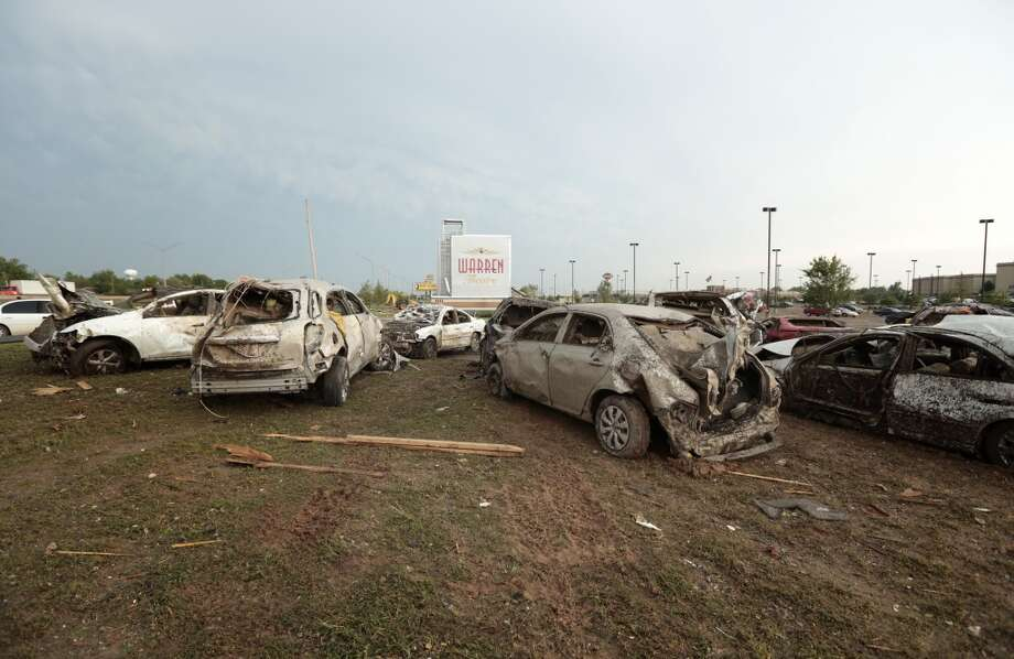 MOORE, OK- MAY 20:  Damaged vehicles are piled up in front of the Moore Warren Theater after a powerful tornado ripped through the area on May 20, 2013 in Moore, Oklahoma. The tornado, reported to be at least EF4 strength and two miles wide, touched down in the Oklahoma City area on Monday killing at least 51 people. (Photo by Brett Deering/Getty Images)