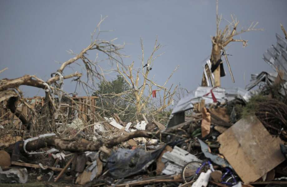 MOORE, OK- MAY 20:  Piles of debris and mangled trees remain after a powerful tornado ripped through the area on May 20, 2013 in Moore, Oklahoma. The tornado, reported to be at least EF4 strength and two miles wide, touched down in the Oklahoma City area on Monday killing at least 51 people. (Photo by Brett Deering/Getty Images)
