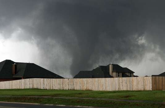 A tornado moves past homes in Moore, Okla. on Monday, May 20, 2013. (AP Photo/Alonzo Adams)