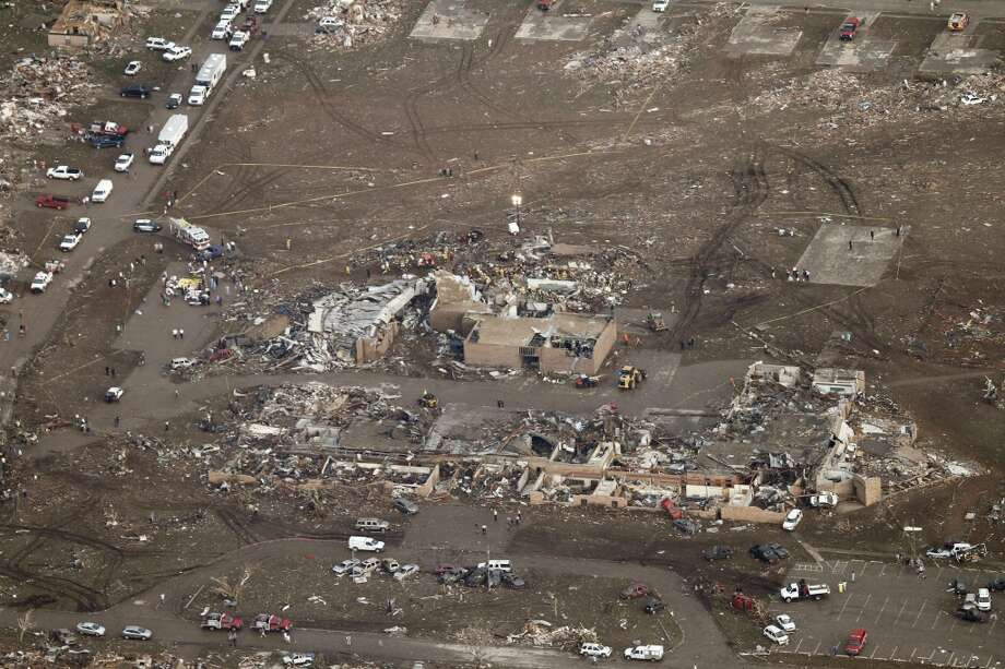 This aerial photo shows damage to Plaza Towers Elementary School after it was hit by a massive tornado in Moore, Okla., Monday May 20, 2013. A tornado roared through the Oklahoma City suburbs Monday, flattening entire neighborhoods, setting buildings on fire and landing a direct blow on an elementary school. (AP Photo/Steve Gooch)
