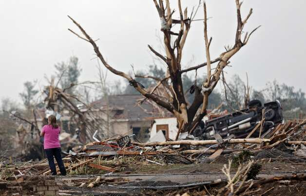 A resident surveys the damage after the tornado hit the area near 149th and Drexel on Monday, May 20, 2013 in Oklahoma City, Okla. (AP Photo/ The Oklahoman, Chris Landsberger)