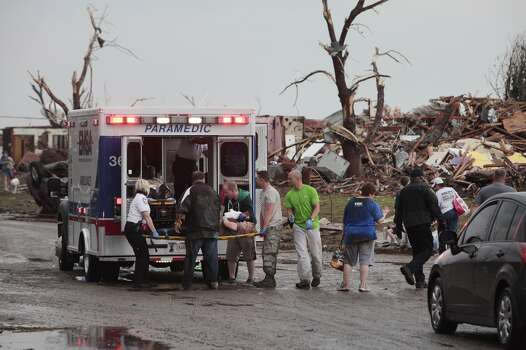 A tornado victim is loaded in an ambulance on Robinson and 142 in south Oklahoma City, Okla., Monday,  May 20, 2013.   (AP Photo/ The Oklahoman,  David McDaniel)