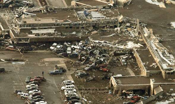This aerial photo shows damage to Moore Medical Center after it was hit by a massive tornado in Moore, Okla., Monday May 20, 2013. A tornado roared through the Oklahoma City suburbs Monday, flattening entire neighborhoods, setting buildings on fire and landing a direct blow on an elementary school. (AP Photo/Steve Gooch)
