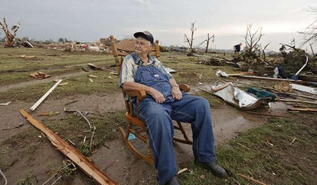 Gene Tripp sits in his rocking chair where his home once stood after being destroyed by a tornado hit the area near 149th and Drexel on Monday, May 20, 2013 in Oklahoma City, Okla.   (AP Photo/ The Oklahoman, Chris Landsberger)