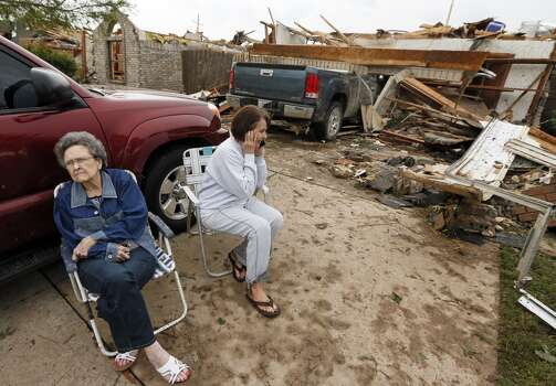 Mary Barnhill, left, sits next to her daughter-in-law Brenda Barnhill after a tornado destroyed the home of Brenda Barnhill and her husband Larry Barnhill, Mary's son, near SW 149th and Vicki Dr., when a tornado struck south Oklahoma City and Moore, Okla., Monday, May 20, 2013. (AP Photo/ The Oklahoman, Nate Billings)