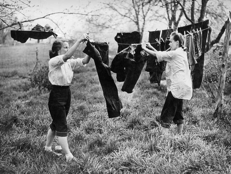These women in the 1940s are hanging their jeans on a laundry line. With the end of World War II and the American intervention around the world, the blue jean gradually began to be marketed everywhere.  (Photo by Keystone-France/Gamma-Keystone via Getty Images)