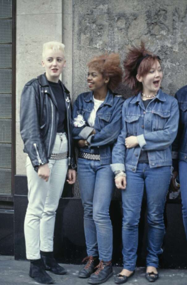 Three teenage girls wearing post punk fashions, 1980.
