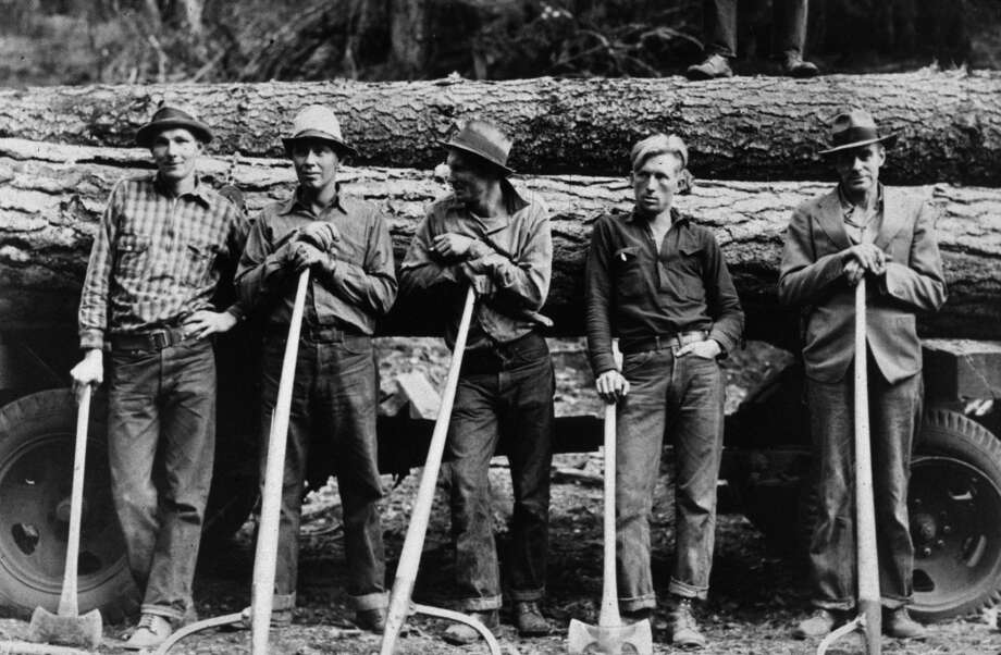 Five farmers standing in front of a load of logs in Ola, Idaho, 1939.  (Photo by Dorothea Lange/Library Of Congress/Getty Images)