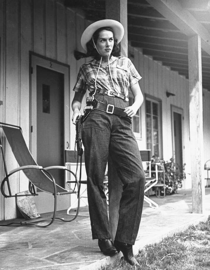 UNITED STATES - CIRCA 1940:  Model wearing rough denim frontier pants and cotton shirt, designed by Marge Riley, at Palm Springs Dude Ranch.  (Photo by Peter Stackpole/Time & Life Pictures/Getty Images)