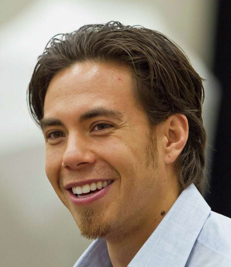 FILE - In this May 9, 2011 file photo, speedskater Apolo Ohno smiles in Omaha, Neb. Ohno is still pondering a final run at the Olympics. With barely a year to go until the Sochi Games, the most decorated U.S. winter athlete is weighing what role he wants to play in 2014. (AP Photo/Nati Harnik, File) Photo: Nati Harnik / AP