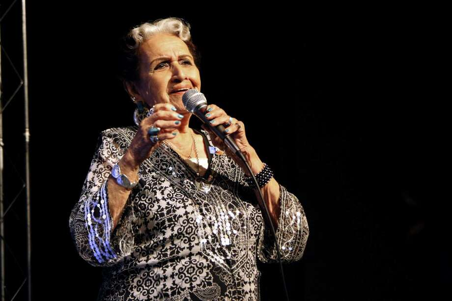 Rita Vidaurri performs at the unveiling of the Lydia Mendoza commemorative stamp on  May 15 at the Guadalupe Theater. Photo: Helen L. Montoya / San Antonio Express-News