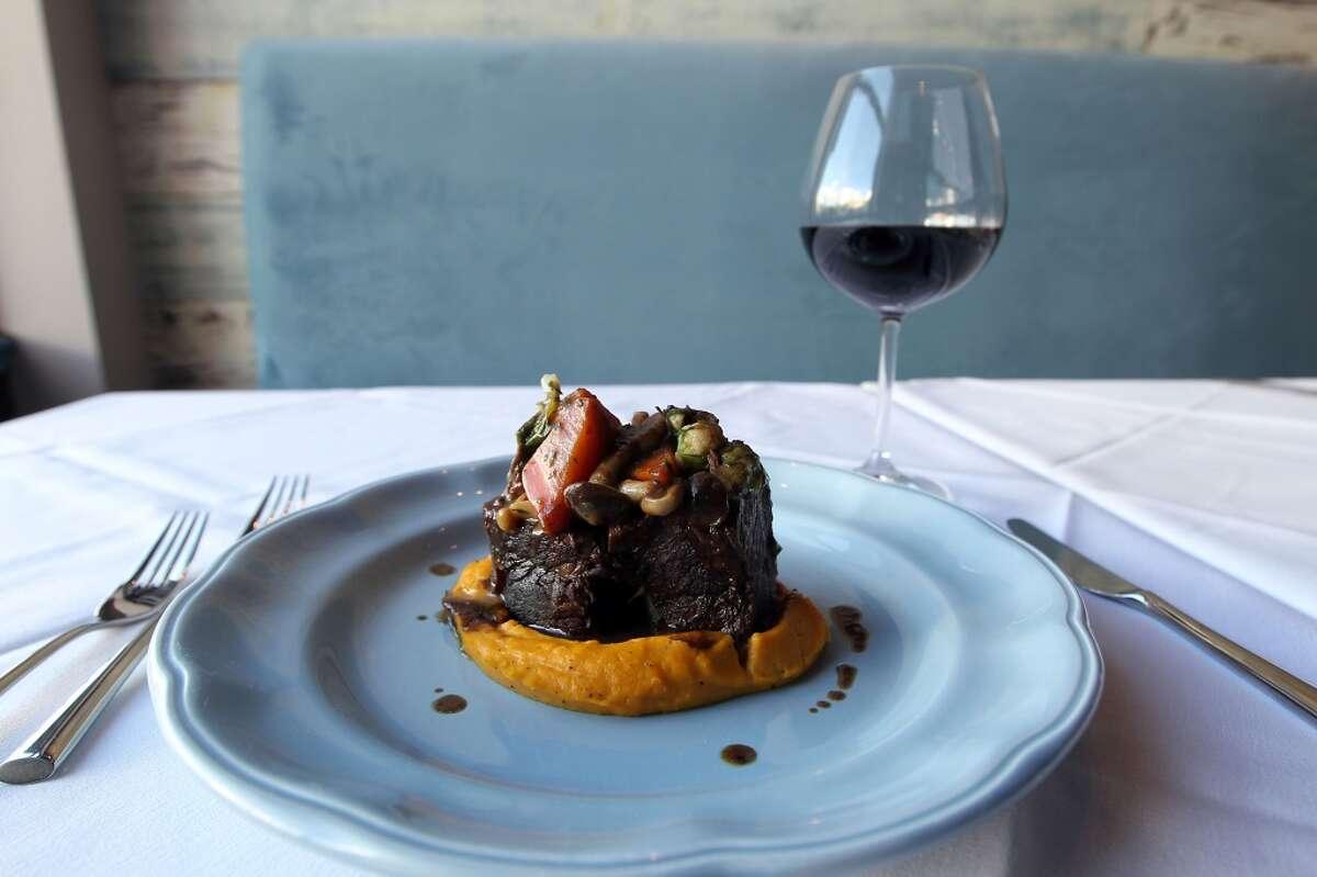 The braised beef short ribs with butternut squash mousseline & fall vegetables at Étoile Cuisine et Bar Thursday, Oct. 25, 2012, in Houston. ( James Nielsen / Chronicle )