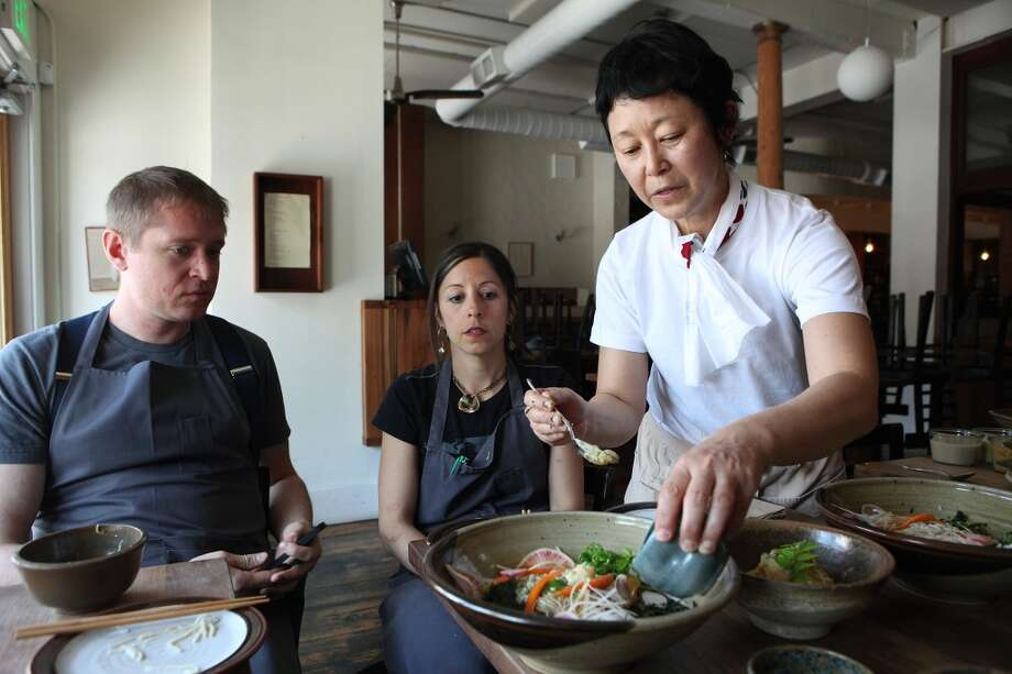 Bar Tartine co-chefs Nick Balla (left) and Cortney Burns (middle) watch as Sonoko Sakai (right) presents dishes she will prepare at a Koji dinner at the restaurant on May 28.