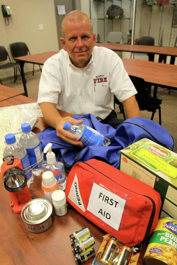 Katy Fire Chief Marc Jordan with a hurricane preparedness kit.  Photo by Suzanne Rehak Photo: Suzanne Rehak, Freelance / Freelance