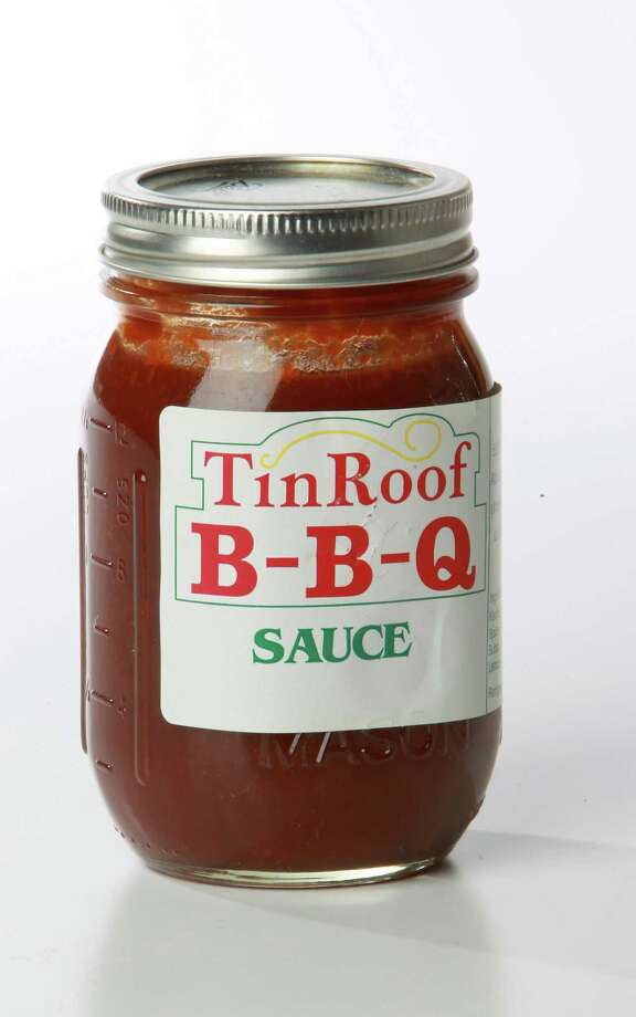 Tin Roof B-B-Q Sauce: Ronnie and Nancy Webber opened Tin Roof BBQ in        2001. Folks may remember the original was just a couple of blocks        outside Memorial Park. Later, the couple moved the business to        Atascocita.