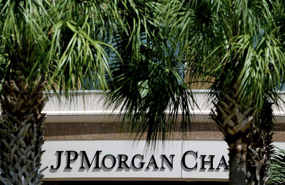 The front of one of the JPMorgan Chase & Co. buildings is shown during the annual meeting Tuesday, May 21, 2013, in Tampa, Fla. It's a pivotal day for Jamie Dimon, head of the country's biggest bank, his shareholders will vote whether to strip him of his role as bank chairman. (AP Photo/Chris O'Meara) Photo: Chris O'Meara