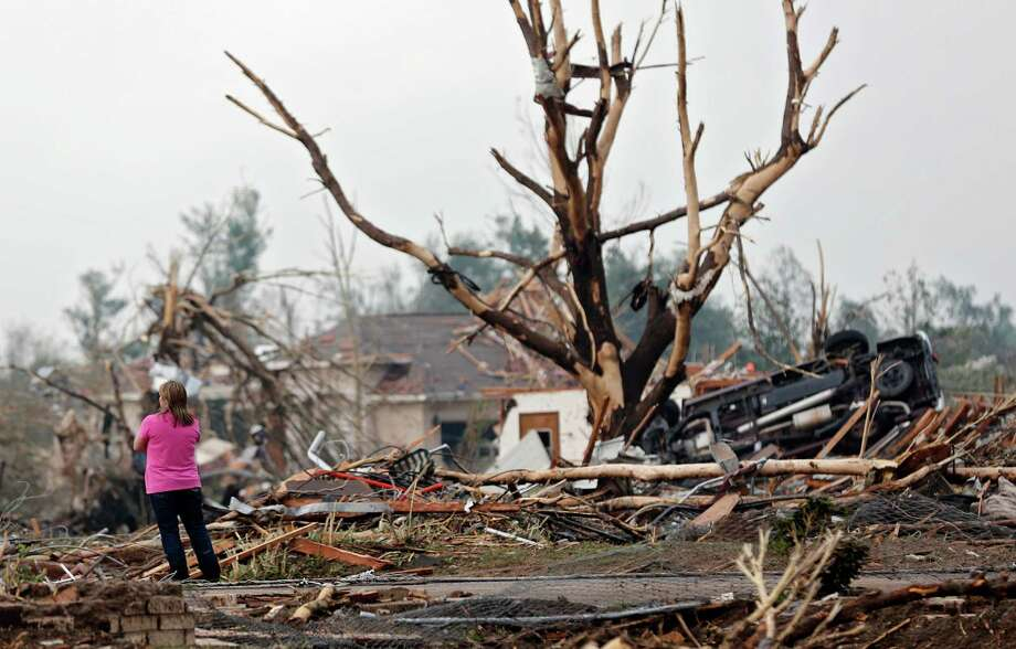 A resident surveys the damage after the tornado hit the area near 149th and Drexel on Monday, May 20, 2013 in Oklahoma City, Okla. Photo: CHRIS LANDSBERGER, Associated Press / The Oklahoman