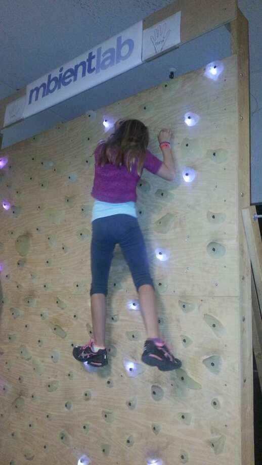 LEDs light the way up the wall for this young climber