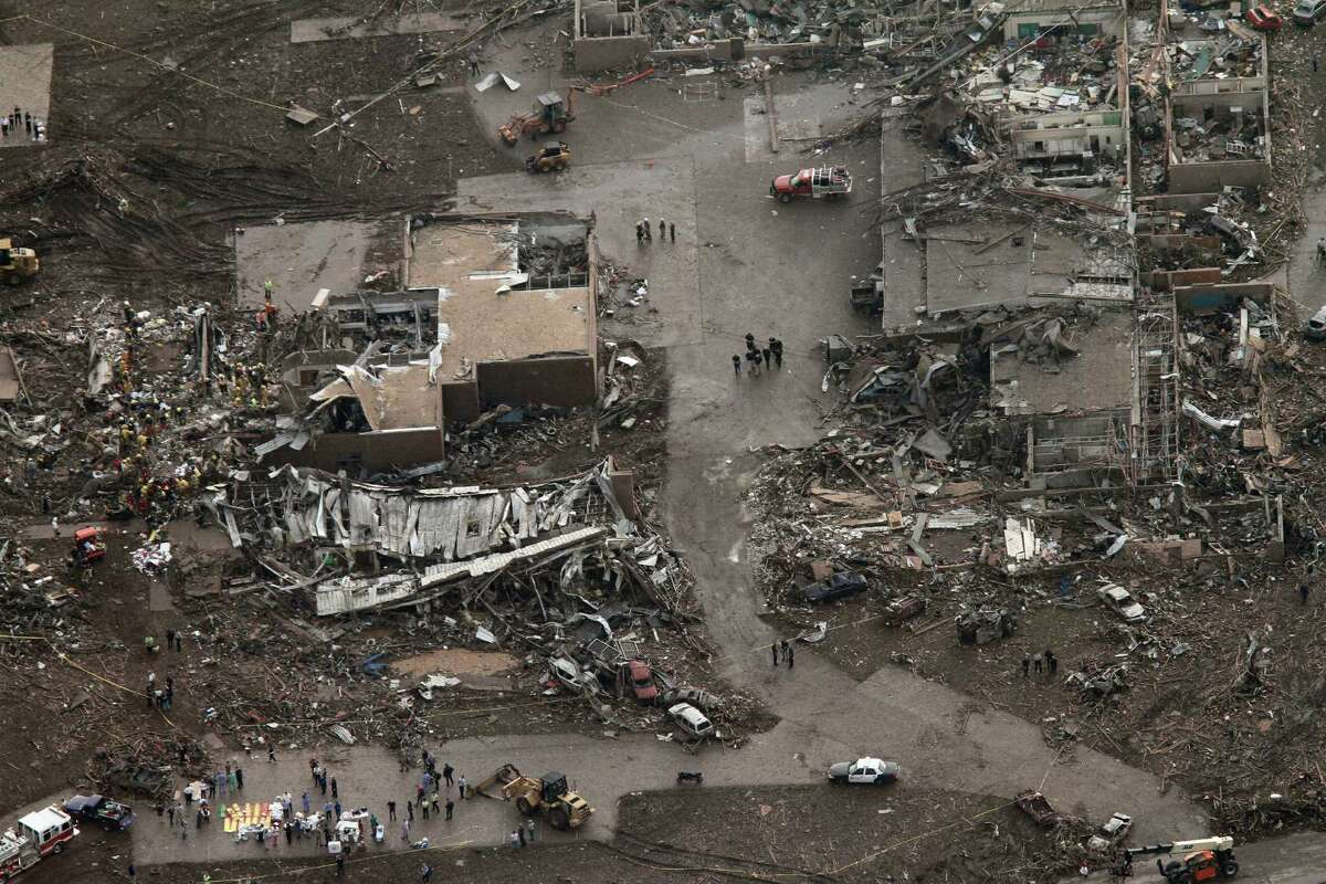This aerial photo shows damage to buildings hit by a massive tornado in Moore, Okla., Monday May 20, 2013. A tornado roared through the Oklahoma City suburbs Monday, flattening entire neighborhoods, setting buildings on fire and landing a direct blow on an elementary school.