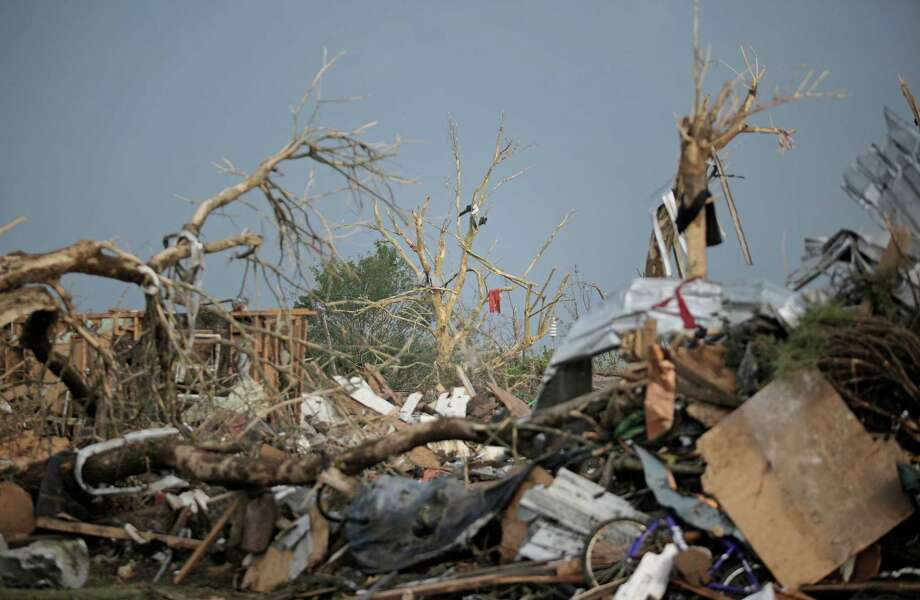 Piles of debris and mangled trees remain after a powerful tornado ripped through the area on May 20, 2013 in Moore, Oklahoma. The tornado, reported to be at least EF4 strength and two miles wide, touched down in the Oklahoma City area on Monday killing at least 51 people. Photo: Brett Deering, Getty Images / 2013 Getty Images