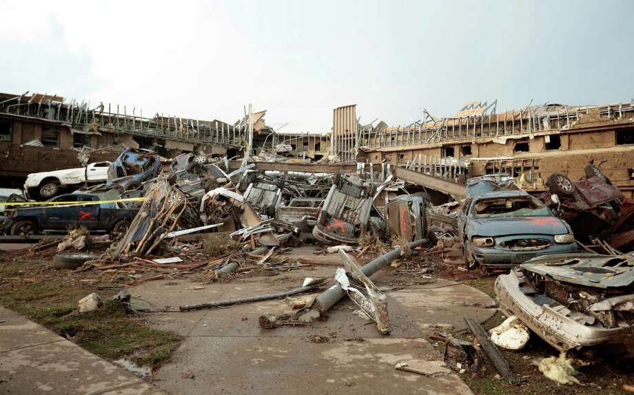Cars marked with an orange 'X', denoting they had been checked for occupants, are piled up in what was the front entrance to the damaged Moore Medical Center after a powerful tornado ripped through the area on May 20, 2013 in Moore, Oklahoma. The tornado, reported to be at least EF4 strength and two miles wide, touched down in the Oklahoma City area on Monday killing at least 51 people. Photo: Brett Deering, Getty Images / 2013 Getty Images