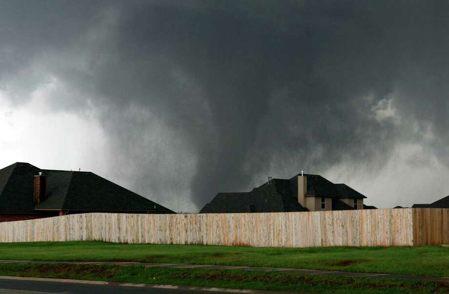 A tornado moves past homes in Moore, Okla. on Monday, May 20, 2013. Photo: Alonzo Adams