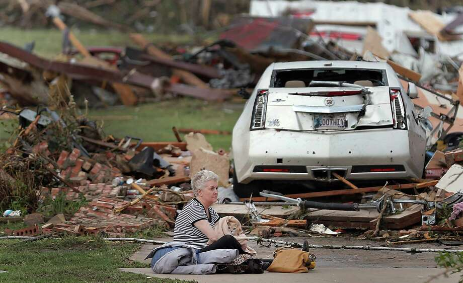 Kay James holds her cat as she sits in her driveway after her home was destroyed by the tornado that hit the area on Monday, May 20, 2013 in Oklahoma City, Okla. Photo: The Oklahoman, Chris Landsberger