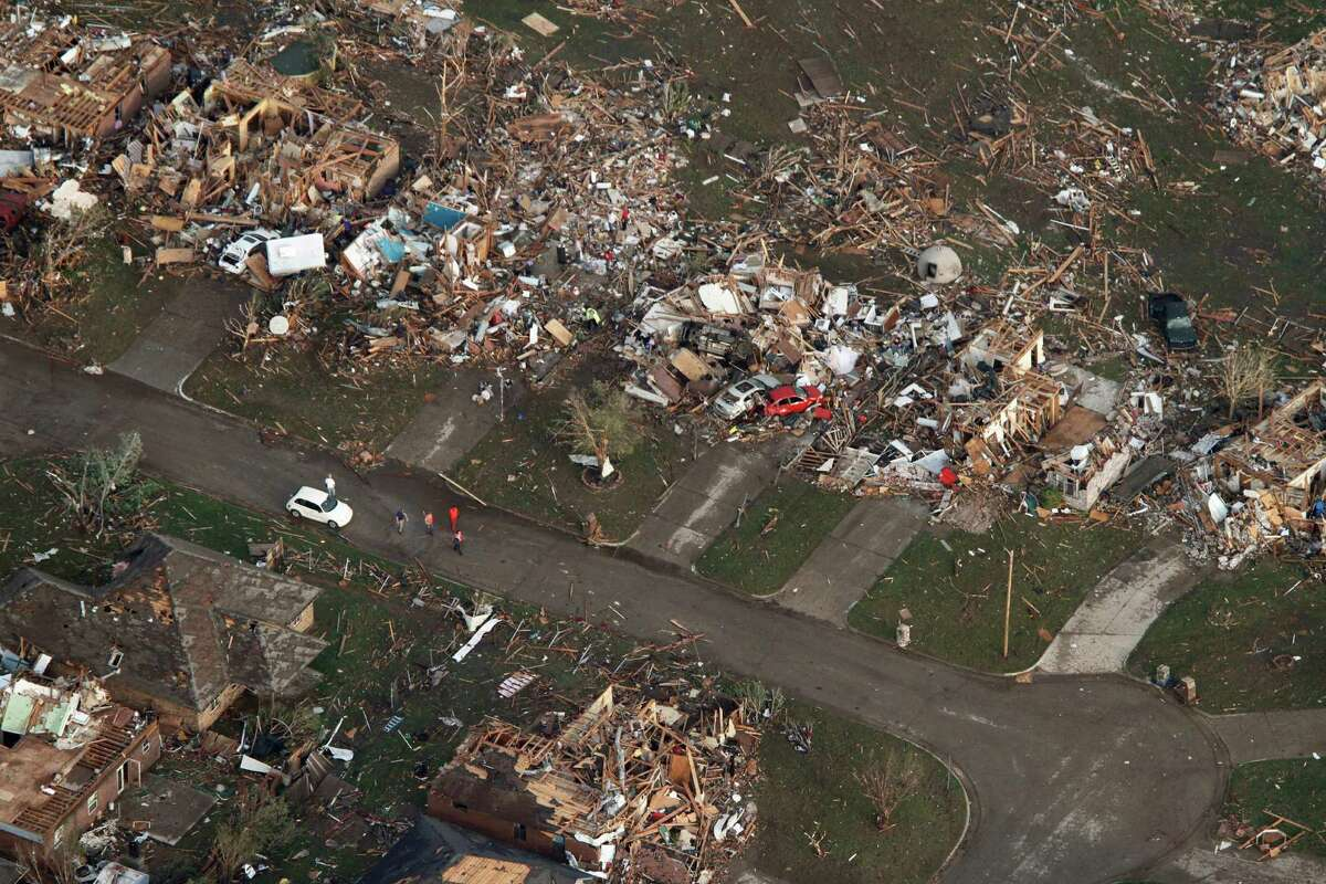 This aerial photo shows the remains of homes hit by a massive tornado in Moore, Okla., Monday May 20, 2013. A tornado roared through the Oklahoma City suburbs Monday, flattening entire neighborhoods, setting buildings on fire and landing a direct blow on an elementary school.
