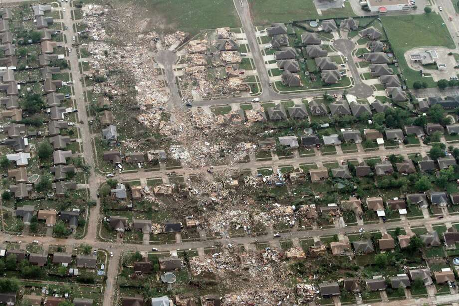 This aerial photo shows the remains of homes hit by a massive tornado in Moore, Okla., Monday May 20, 2013. A tornado roared through the Oklahoma City suburbs Monday, flattening entire neighborhoods, setting buildings on fire and landing a direct blow on an elementary school. Photo: Steve Gooch