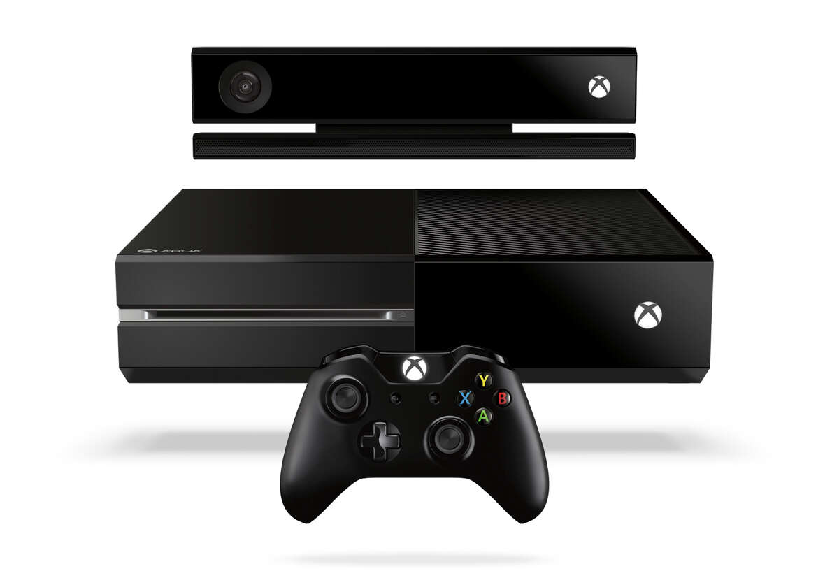 This product image released by Microsoft shows the new Xbox One entertainment console that will go on sale later this year. Microsoft is seeking to stay ahead of rivals in announcing that new content that can be downloaded for the popular