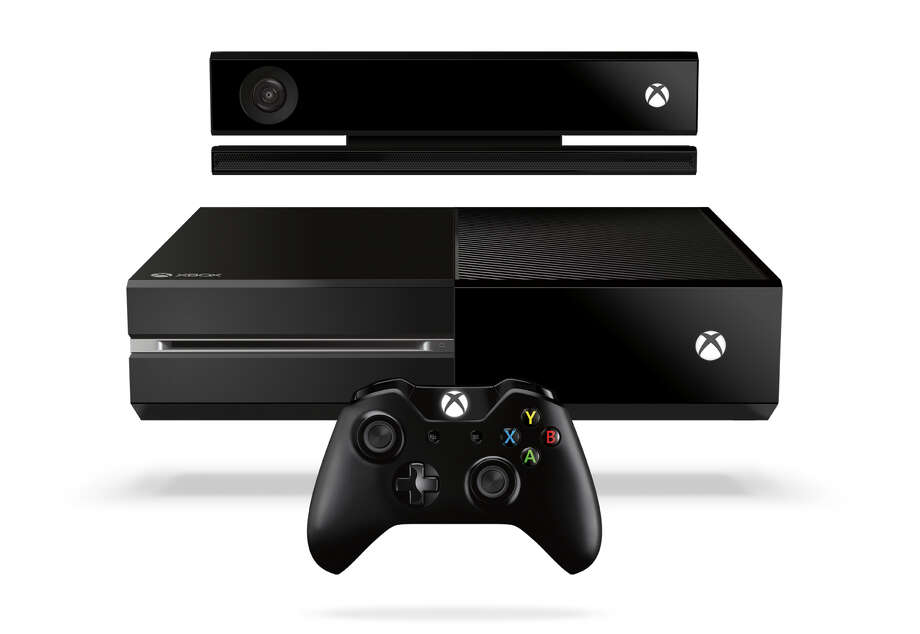 "This product image released by Microsoft shows the new Xbox One entertainment console that will go on sale later this year.  Microsoft is seeking to stay ahead of rivals in announcing that new content that can be downloaded for the popular ""Call of Duty"" game will launch first on Xbox One.  Microsoft says more games will be shown at next month's E3 video game conference in Los Angeles.  (AP Photo/Microsoft) Photo: Associated Press / Microsoft"