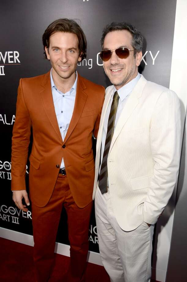 "WESTWOOD, CA - MAY 20:  Actor Bradley Cooper (L) and director Todd Phillips arrive at the premiere of Warner Bros. Pictures' ""Hangover Part 3"" on May 20, 2013 in Westwood, California.  (Photo by Kevin Winter/Getty Images)"