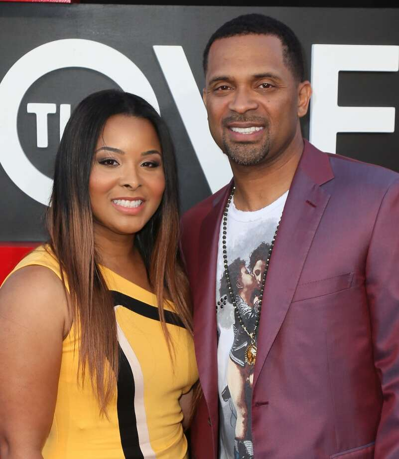 "WESTWOOD, CA - MAY 20:  Actor Mike Epps (R) and wife Mechelle McCain attend the premiere of Warner Bros. Pictures' ""Hangover Part III"" at the Westwood Village Theater on May 20, 2013 in Westwood, California.  (Photo by David Livingston/Getty Images)"