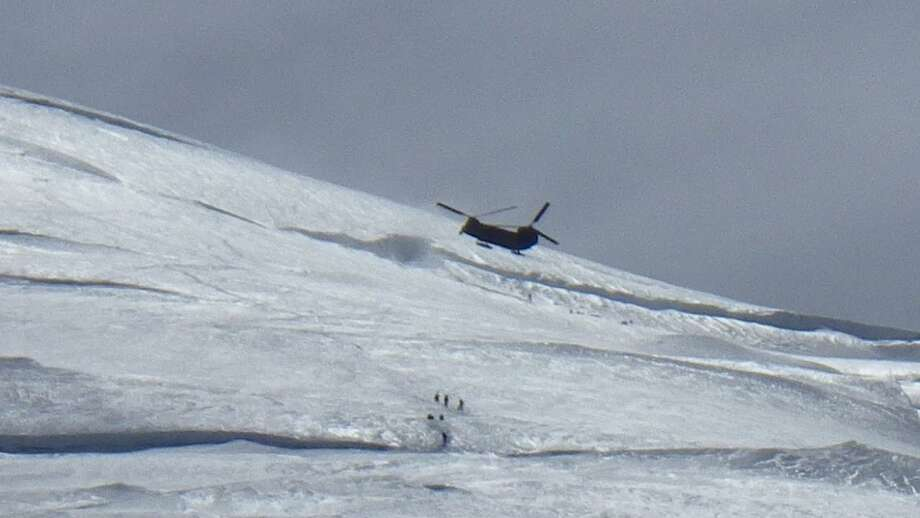Army Chinook over the top of four Texans being rescued on Mount Rainier (by Claire Kultgen) June 21, 2012 Photo: Picasa