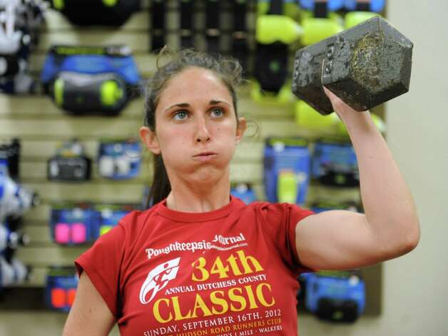 UAlbany student Mary Veltre of Pougkeepsie does some reps with a dumbbell as employees and members of the Fleet Feet team do their twice-weekly strength training session at Fleet Feet Sports on Wednesday, May 15, 2013 in Colonie, N.Y. (Lori Van Buren / Times Union) Photo: Lori Van Buren / 00022331A