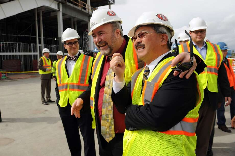 Santa Clara Mayor Jamie Matthews (left) and San Francisco Mayor Ed Lee look at the new 49ers stadium before meeting with the media in Santa Clara in March to discuss the bid for the Super Bowl.