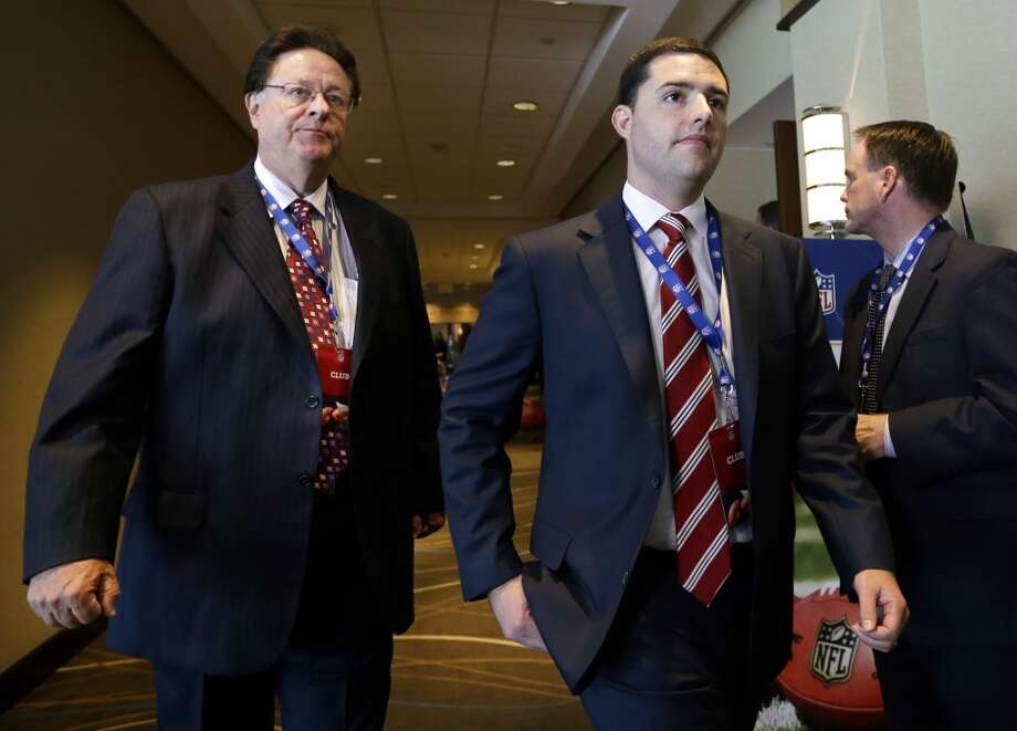 San Francisco 49ers football team owner John York, left, walks through a hotel with his son, 49ers CEO Jed York, during a break in the NFL spring meeting in Boston, Tuesday, May 21, 2013.