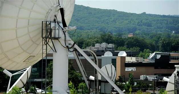 In this Aug. 2, 2011 file photo, satellite dishes dot the campus of ESPN in Bristol, Conn. Photo: Jessica Hill, AP / AP