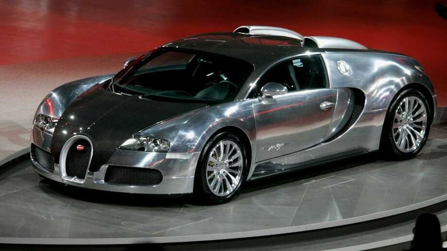 Bugatti Veyron Super Sport: 267 mph, 0-60 in 2.4 secs.