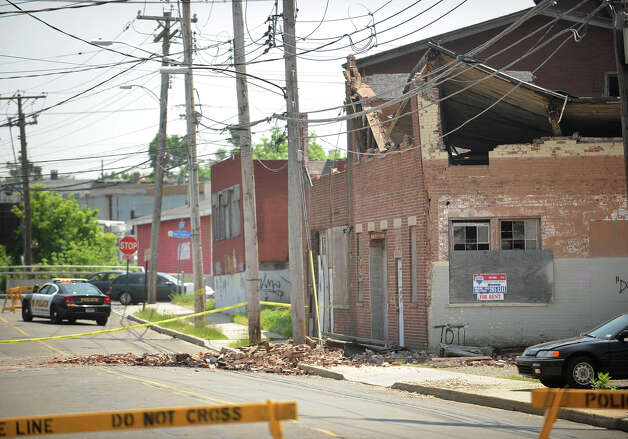 A roof and partial wall collapse at an unoccupied building at 40 River Street in Bridgeport, Conn. caused a section of the street to be closed to traffic on Tuesday, May 21, 2013. Photo: Brian A. Pounds / Connecticut Post