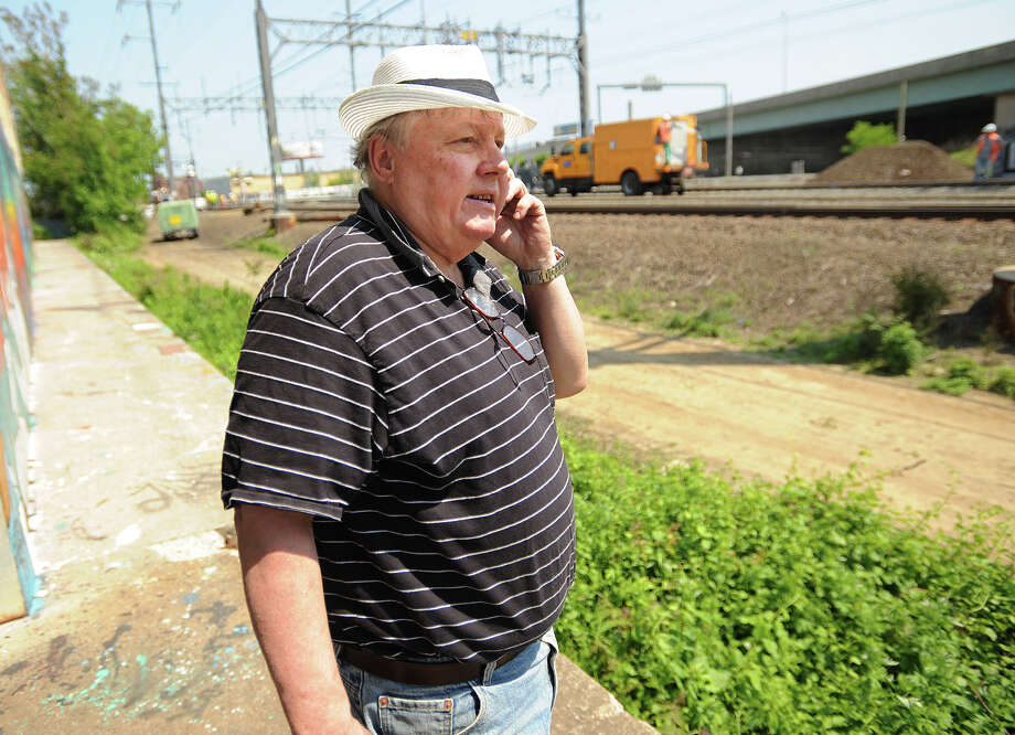 James Repass of Boston, MA, president of National Corridors Initiative, a group dedicated to the modernization of our country's rail service, surveys the site of Friday's derailment and collision in Bridgeport, Conn. on Tuesday, May 21, 2013. Photo: Brian A. Pounds / Connecticut Post